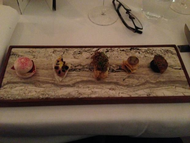 "From left to right: 1) macaroon with beetroot, goose liver parfait 2) crispy pork rind with more pork on top 3) This one is a bit vague, bit I'm pretty sure it featured deep fried moss 4) Crispy celeriac, truffle ... 5) ""Blood pancake"" with fried foie gras"